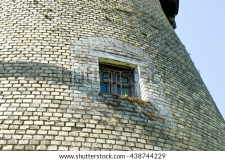 old windmill detail - window - copy space - stock photo
