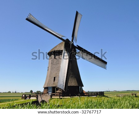 Old windmill in a Dutch countryside - stock photo
