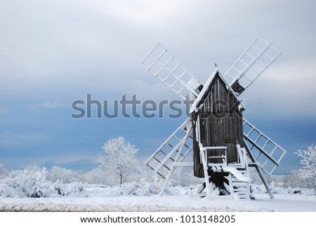 Old windmill in a winter wonderland at the swedish island Oland - the island of sun and wind