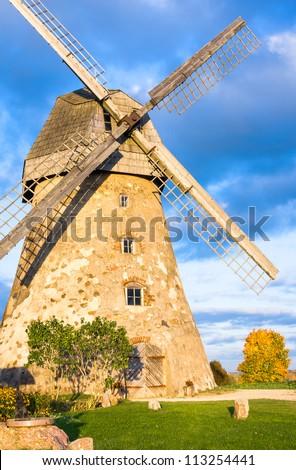 Old windmill in autumn sun - stock photo