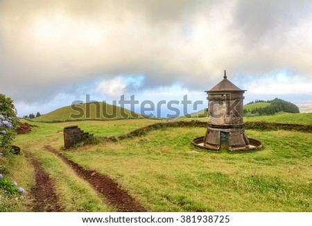 Old windmill in Azores Islands, Portugal - stock photo
