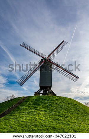 Old windmill in Bruges on a beautiful day, Belgium