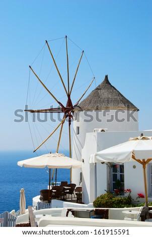 Old windmill in Oia village (Santorini island, Greece) - stock photo