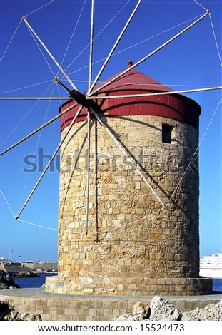 Old windmill in port of Rhodes, Greece - stock photo