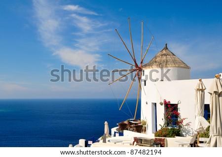 Old windmill in Santorini overlooking the sea - stock photo