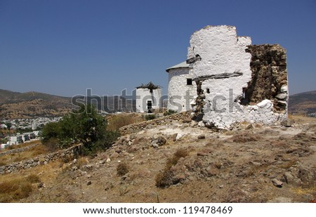 Old windmill on a hill in Bodrum, Turkey in summer day