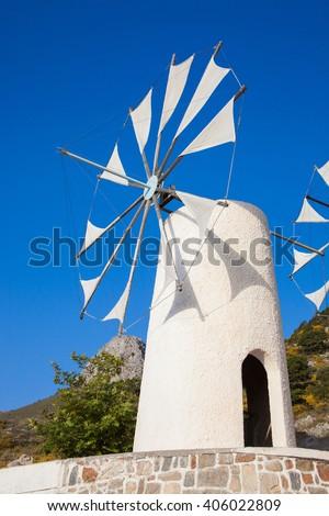 Old windmill on the Lassithi Plateau on Crete, Greece - stock photo
