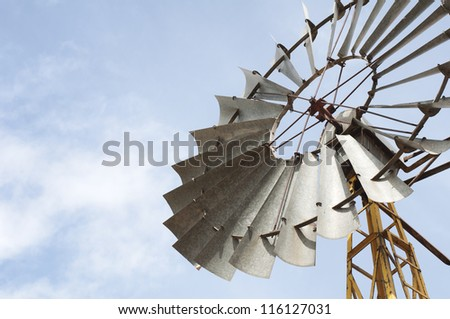 Old windmill over blue sky - stock photo