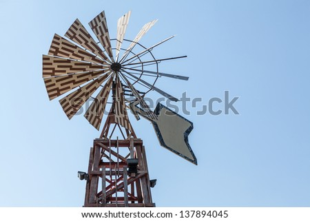 Old windmill over blue sky