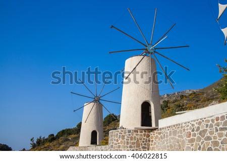 Old windmills on the Lassithi Plateau on Crete, Greece - stock photo