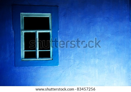 Old window and blue wall - stock photo