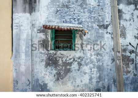 Old window and wall in Penang. Old and Vintage wall  space for background and copy.
