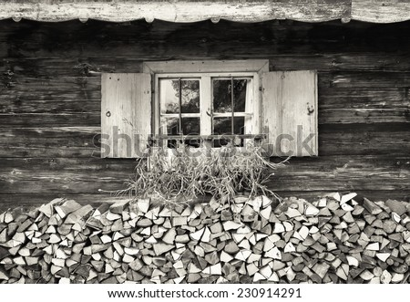 old window at a farm - firewood - stock photo