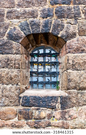 Old window at the medieval castle in Vyborg, Russia - stock photo