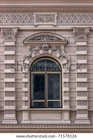 Old window, decorated with stylized columns - stock photo