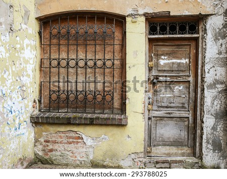 Old window, door and lantern in an ancient European stone house. - stock photo