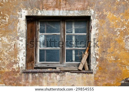 old window from an empty leave house - stock photo