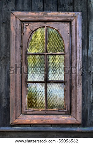 old window in a wooden wall - stock photo