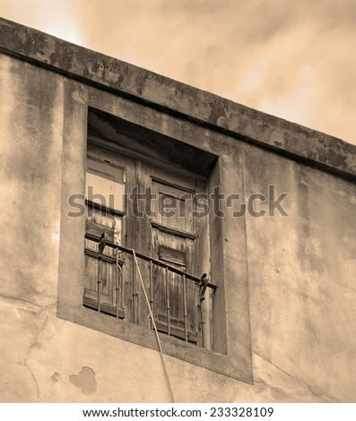 old window in vintage tone. Shot in Bosa, Italy - stock photo