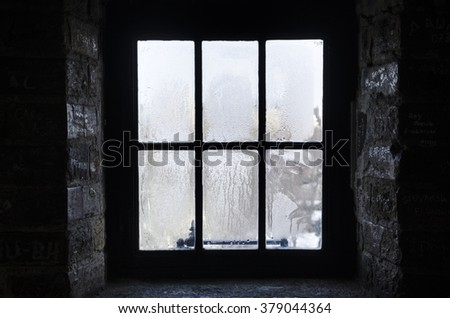Old Window On Cold Rainy Day Stock Photo 379044364