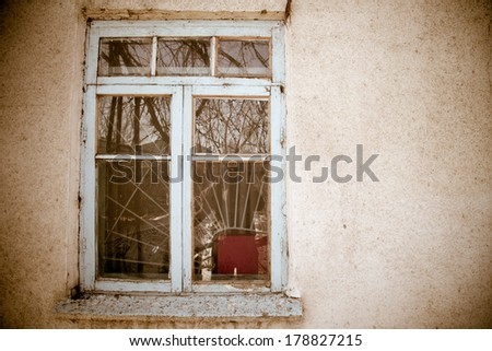 Old window on a concrete wall - stock photo