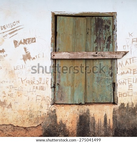 Old window on old wall - stock photo