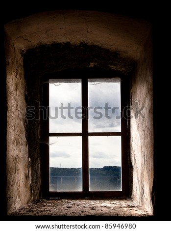 Old Window Set in an Ancient Stone Building - stock photo