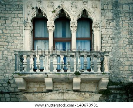 old window with a small balcony, in city of Zadar, Dalmatia, Croatia - stock photo