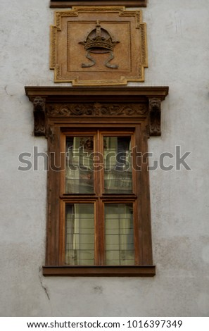 Old window with brown ornamented framework