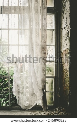 old window with curtain - stock photo
