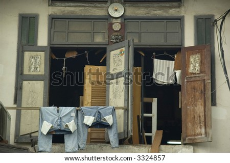 Old window with hanging jeans