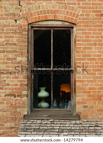 Old window with lamp and bottles - stock photo