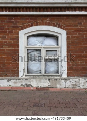 Old window with pillows inside.