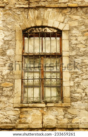 old window with rock wall