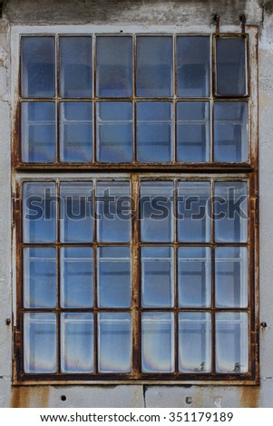 Old window with rusty frame - stock photo
