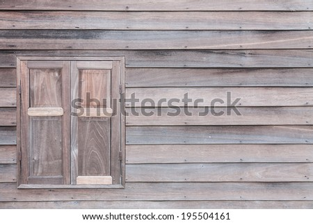 old window with vintage wood wall - stock photo