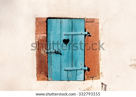 Old window with wooden shutters - stock photo