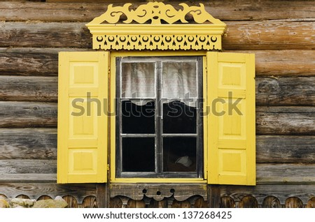 Old Window With Yellow Frame And Shutters - stock photo