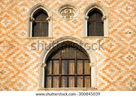Old windows and ornament wall at San Marco square in Venice, Italy - stock photo