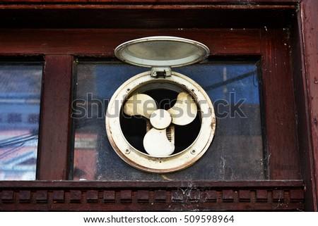 Old windows and ventilation fan. & Old Windows Ventilation Fan Stock Photo (Royalty Free) 509598964 ...
