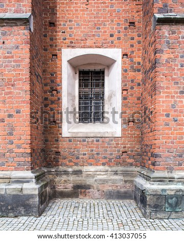 Old windows in red brick wall, church or cathedral. - stock photo