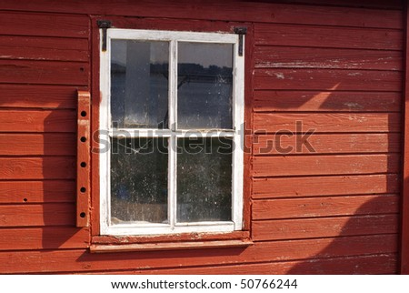 Old windows missing paint on cottages. Limfjord, Denmark, Scandinavia - stock photo