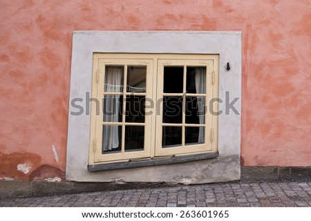 Old Windows on Colorful Wall - stock photo