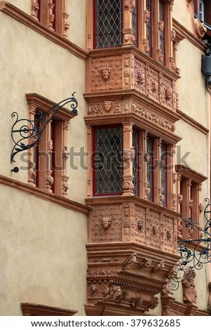 Old windows with stucco molding in traditional house in Colmar, vertical photo - stock photo