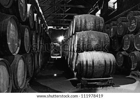 Old wine barrels in a wine cellar - stock photo