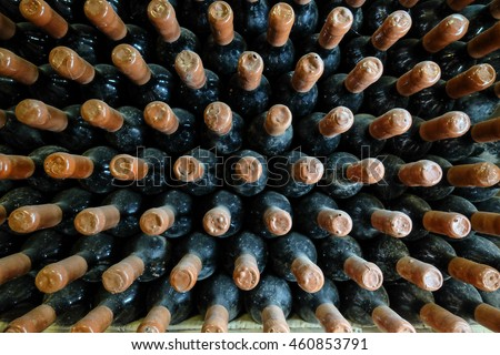 Old wine bottles in cellar.