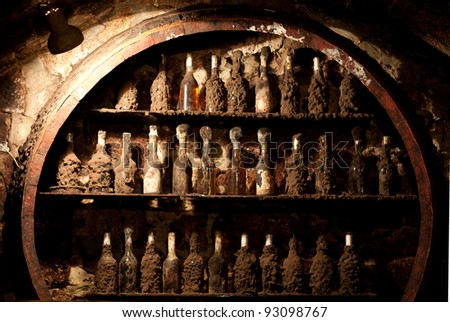 Old wine cellar with many dusty wine bottles