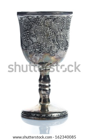 Old wine goblets on white background - stock photo