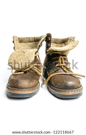 old winter and mountain boots on white background