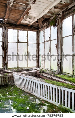 old winter garden - derelict room with large windows - stock photo